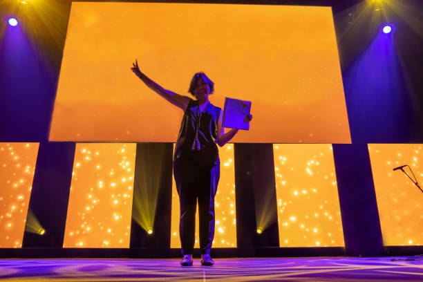 Woman With Success Standing on an Illuminated Stage stock photo