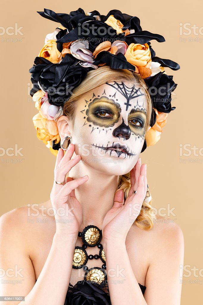 woman with sugar skull makeup stock photo