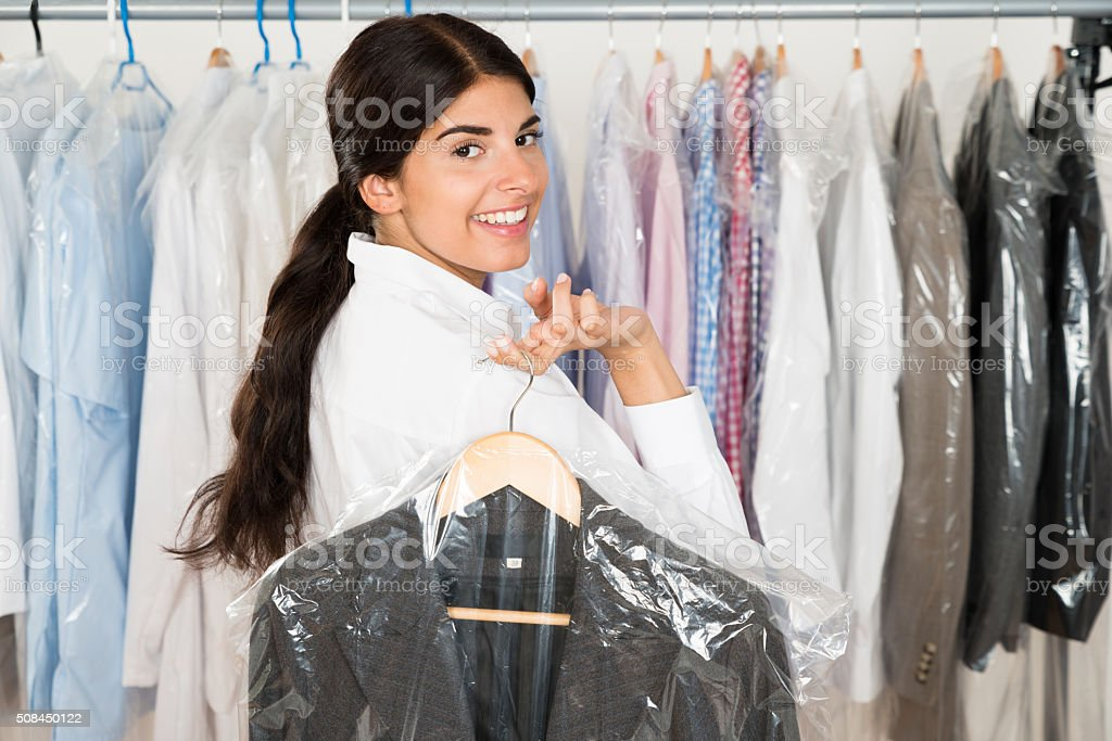 Woman With Suit In Shop stock photo