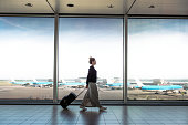 istock Woman with suitcase is going to board on the next flight 900969106