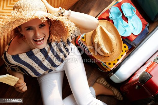 istock woman with summer hat eating ice cream packing for vacation 1155566600