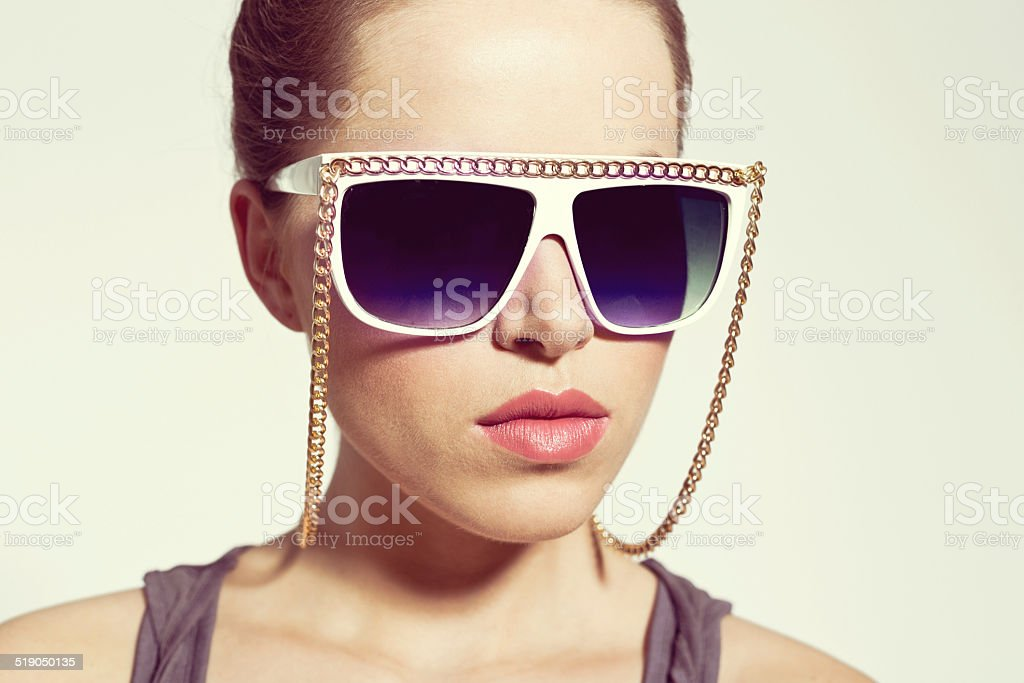Woman with Sunglasses Portrait of sensual young woman wearing sun glasses. 20-24 Years Stock Photo