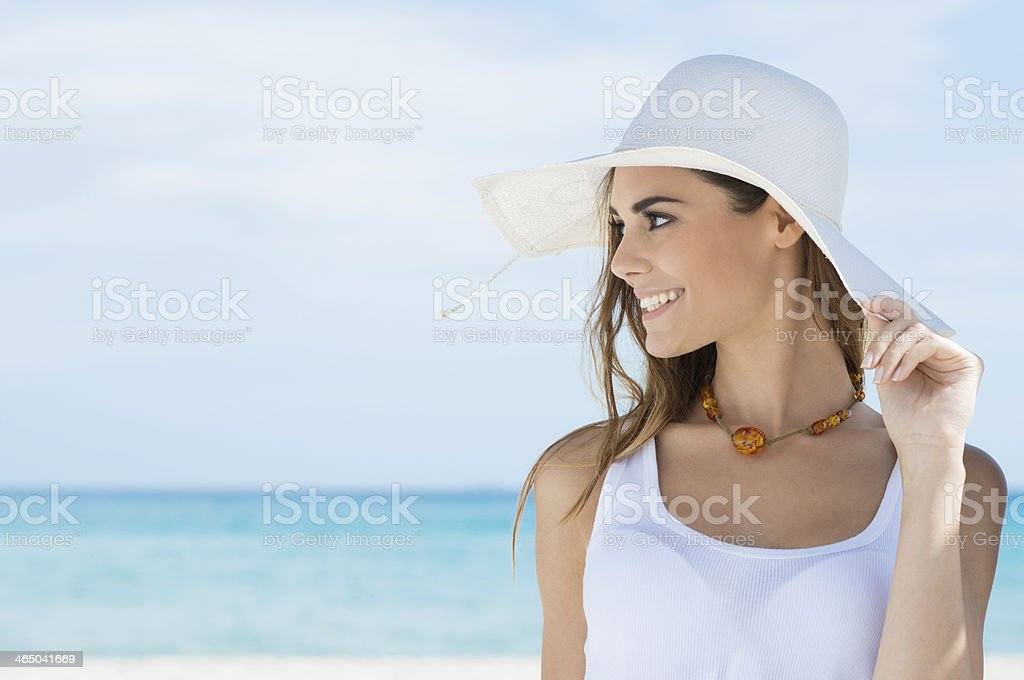 Woman With Sunhat At Beach stock photo