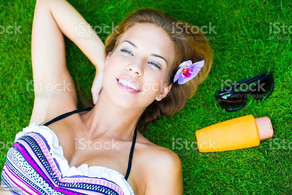 Woman With Suntan Lotion At The Beach stock photo