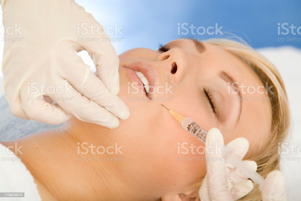 Woman with syringe royalty-free stock photo