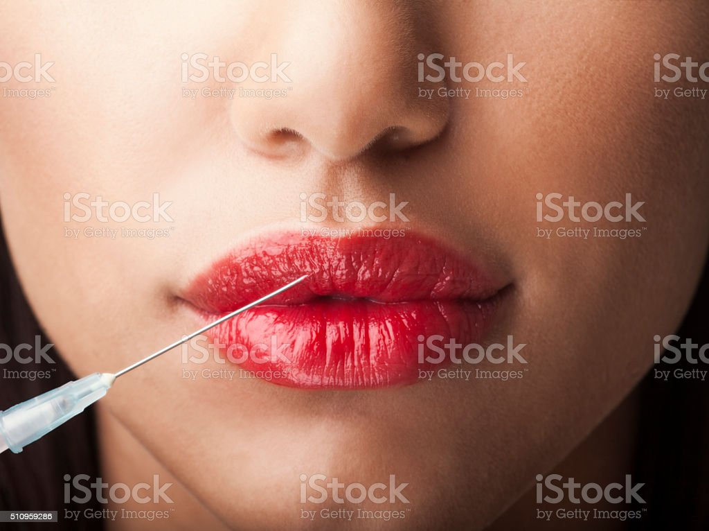 Woman with syringe stock photo