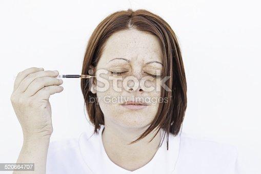 140378701 istock photo Woman with syringe 520664707