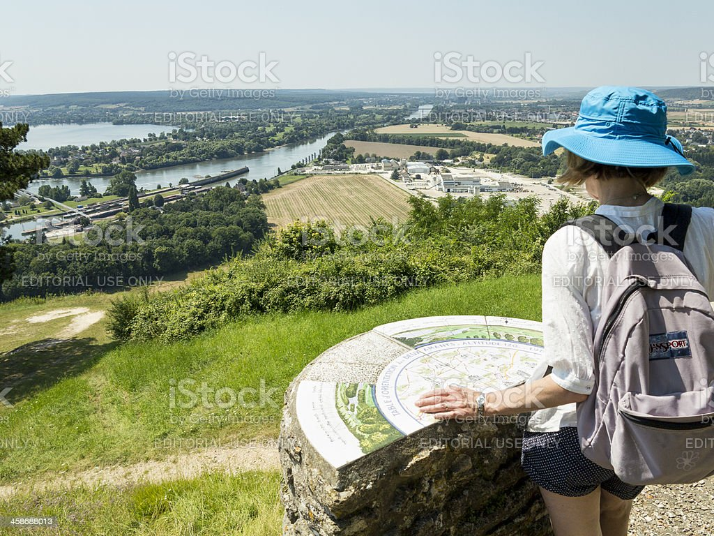 Woman with table map viewing Seine Valley stock photo