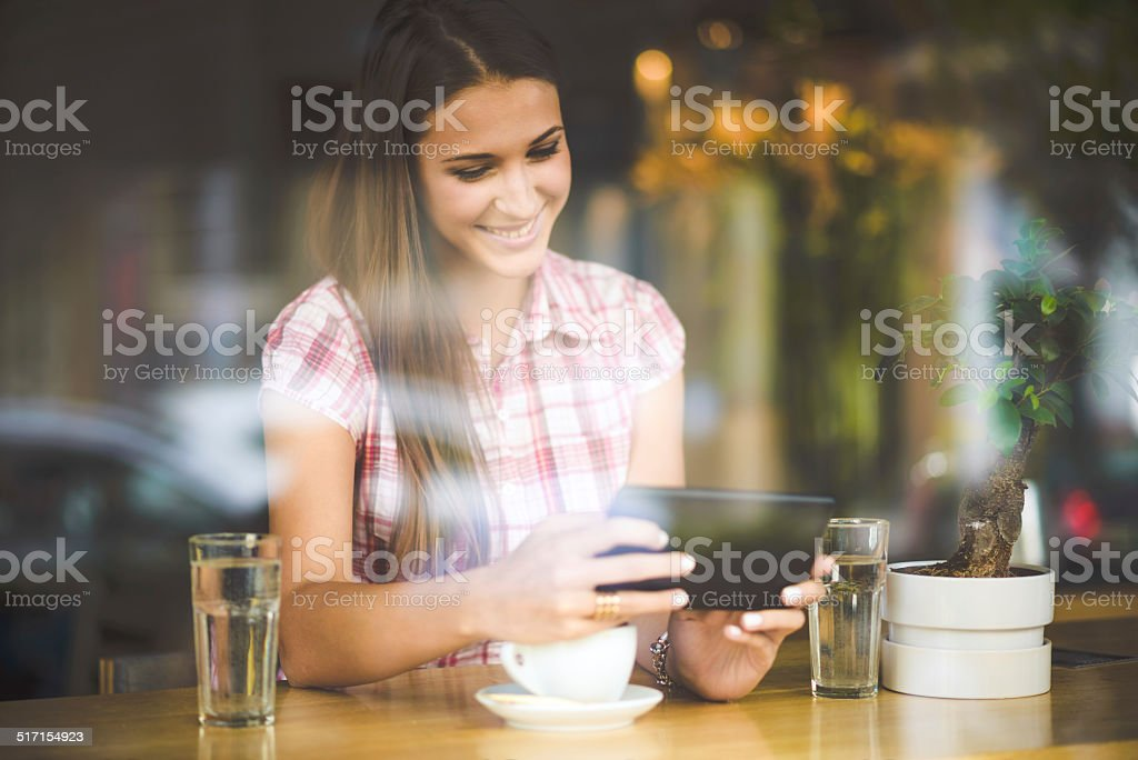 Woman with tablet computer in cafe stock photo