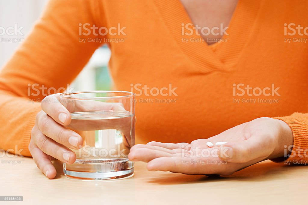 Woman with tablets and water stock photo