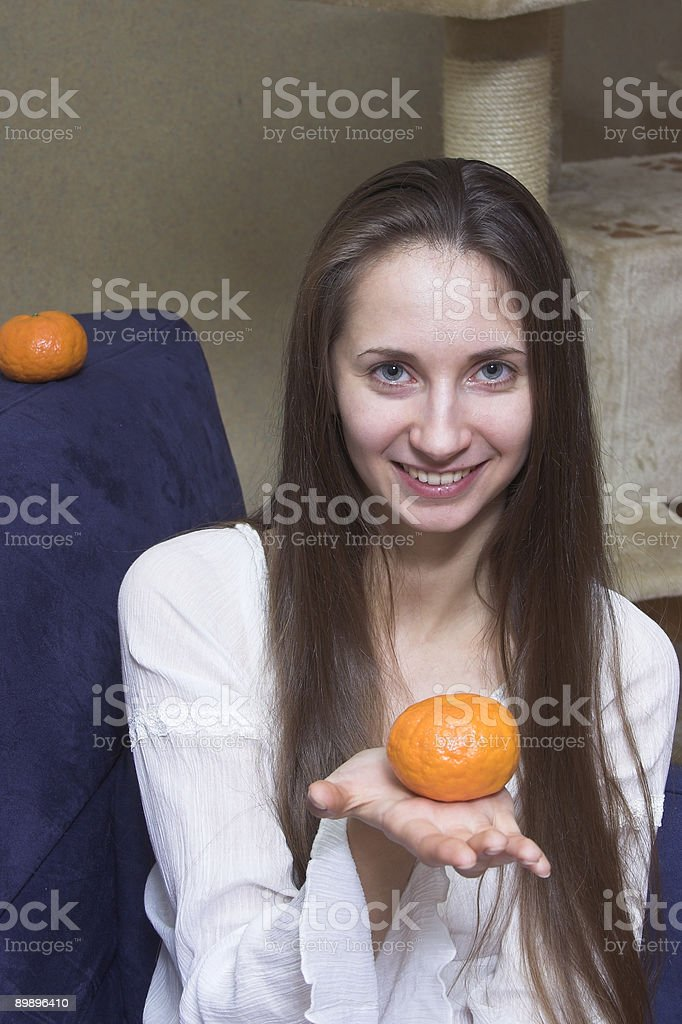 woman with tangerine royalty-free stock photo