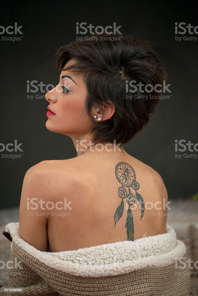 Woman with tatoo stock photo