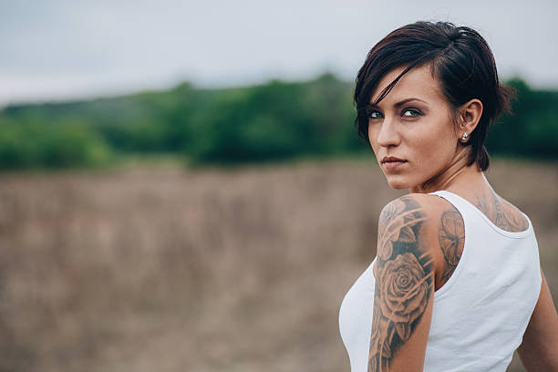woman with tattoo - tattoo stock photos and pictures