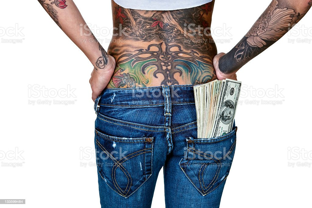 Woman with tattooed back and cash in pocket royalty-free stock photo