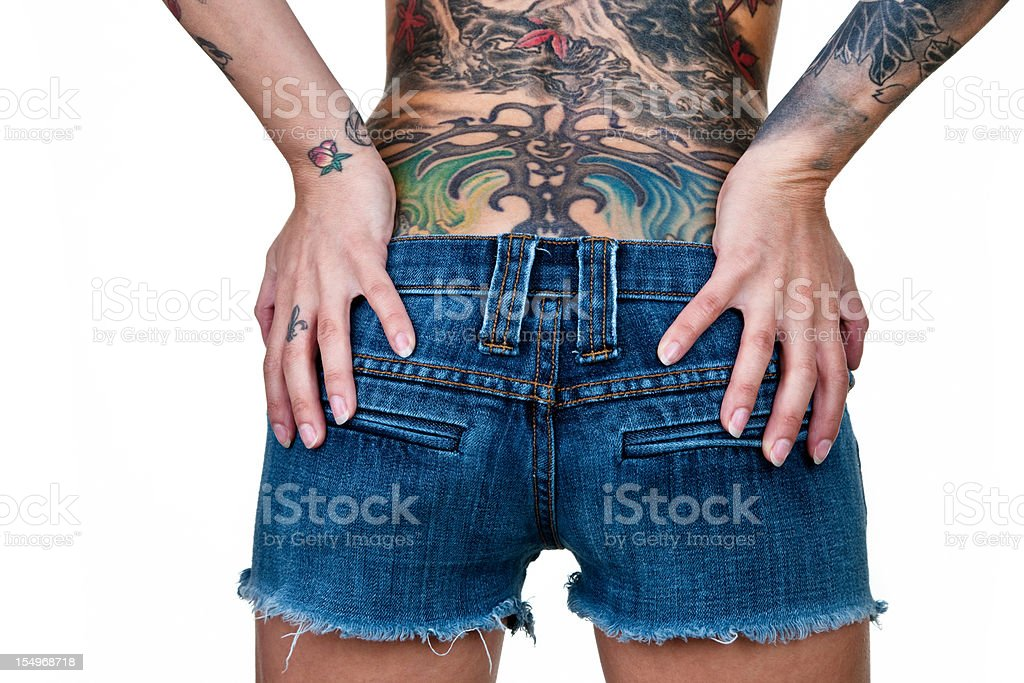 Woman with tattoos shot from the rear royalty-free stock photo