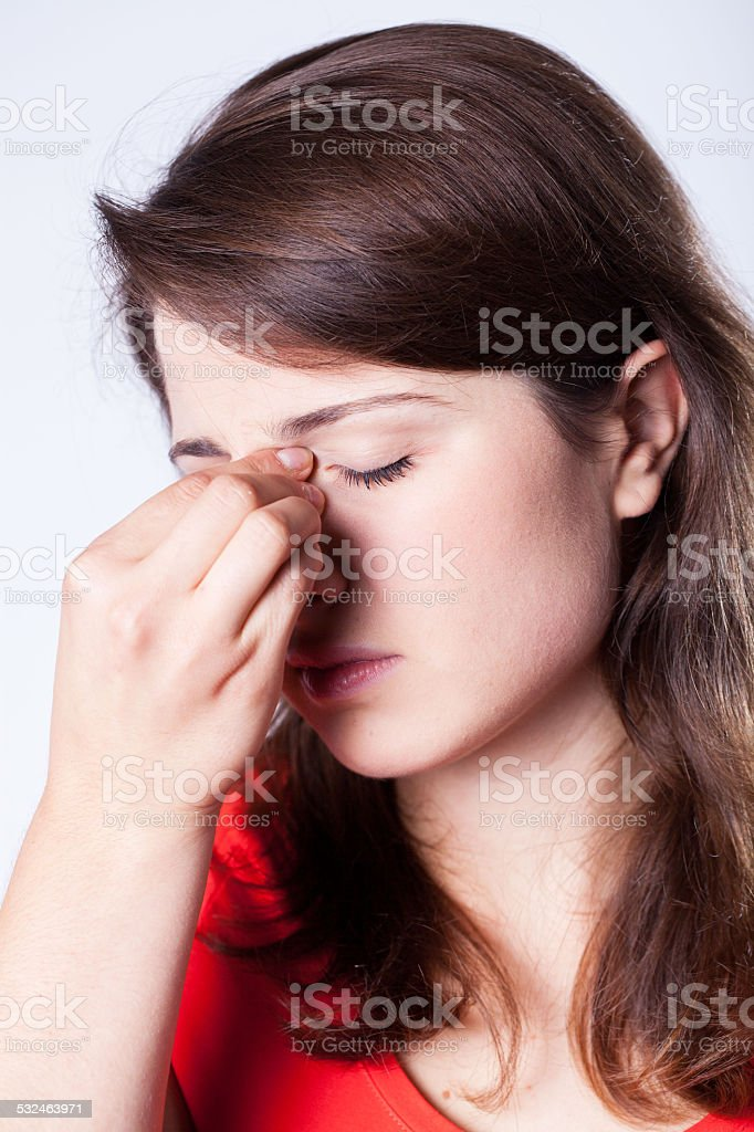 Woman with temple pain stock photo