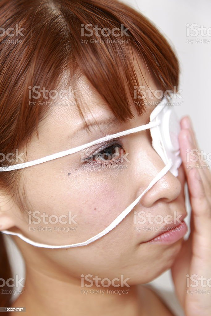 woman with the eyepatch stock photo
