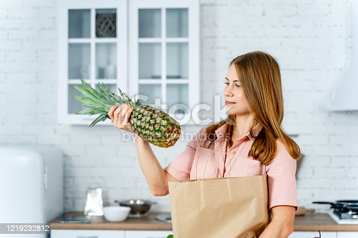 istock woman with the grocery store packet in the hands. 1219232812