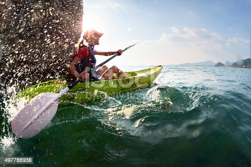 istock Woman with the kayak 497788936