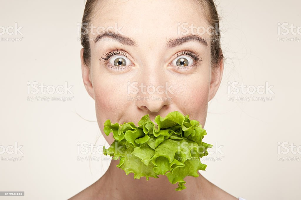 Woman with the lettuce stock photo