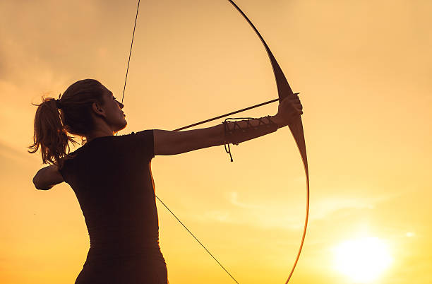 Woman with the longbow stock photo