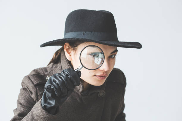Woman with the magnifying glass Woman with the magnifying glass detective stock pictures, royalty-free photos & images