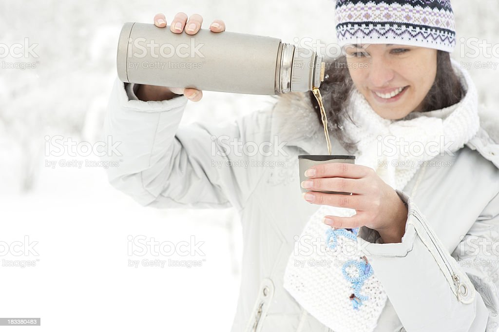 Woman with thermos and cup of tea royalty-free stock photo