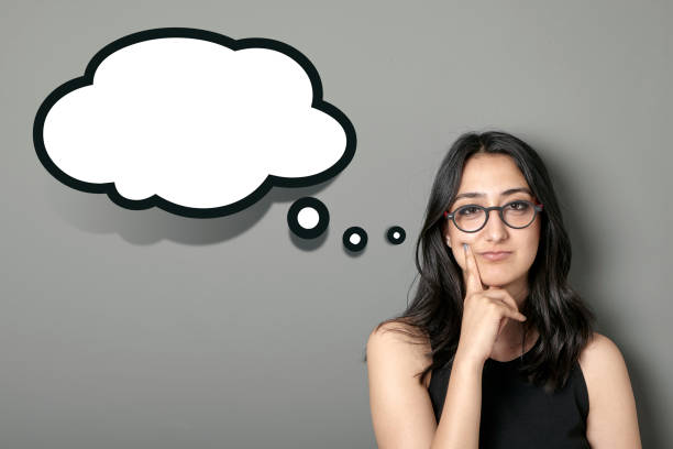 woman with thought bubbles - thought bubble stock photos and pictures