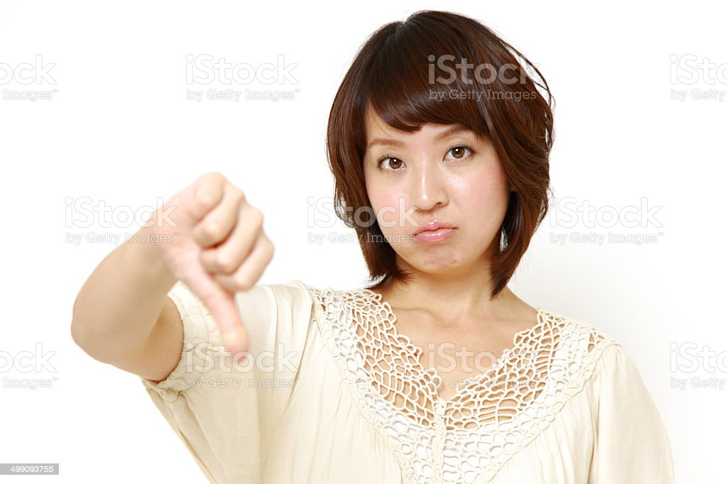 woman with thumbs down gesture royalty-free stock photo