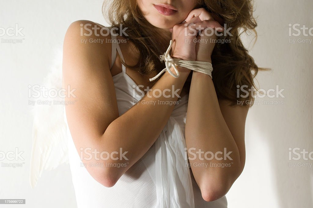 Woman with Tied Hands stock photo