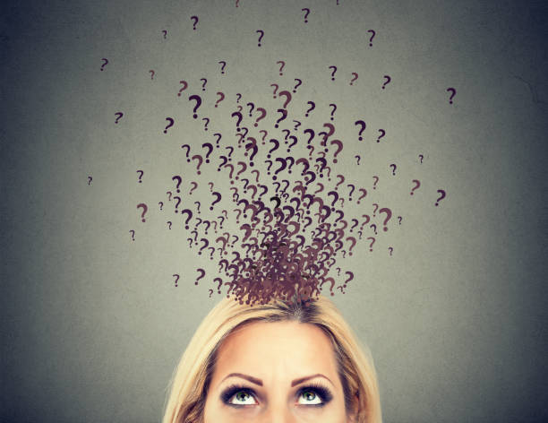 woman with too many questions and no answer - stupidblonde stock pictures, royalty-free photos & images