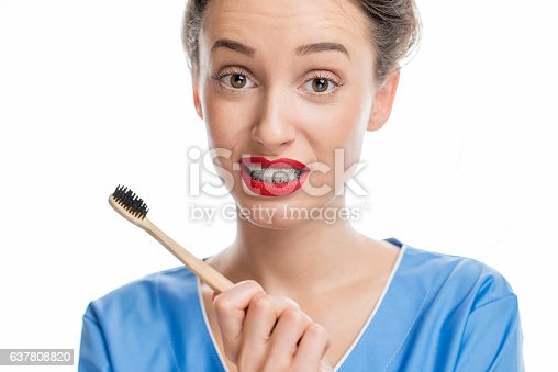 istock Woman with tooth braces 637808820