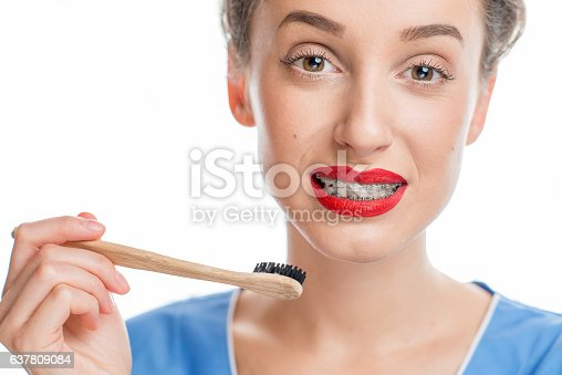 istock Woman with tooth braces 637809084