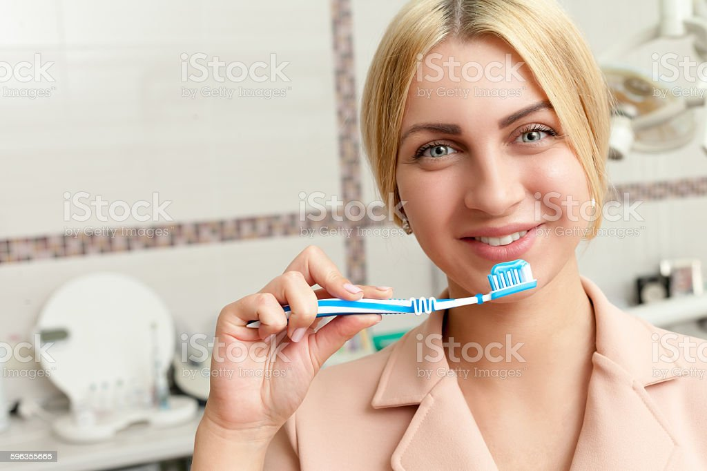 Woman with tooth brush royalty-free stock photo