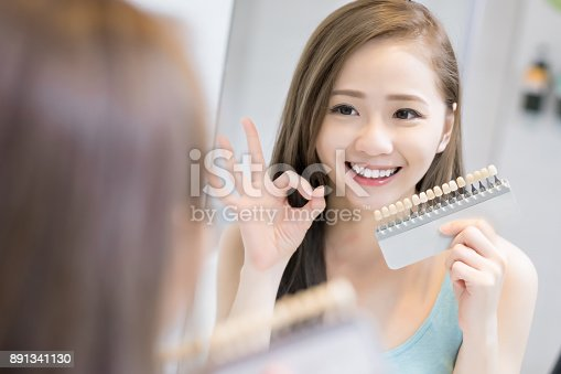 istock woman with tooth color palette 891341130