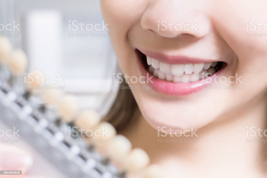 woman with tooth color palette stock photo