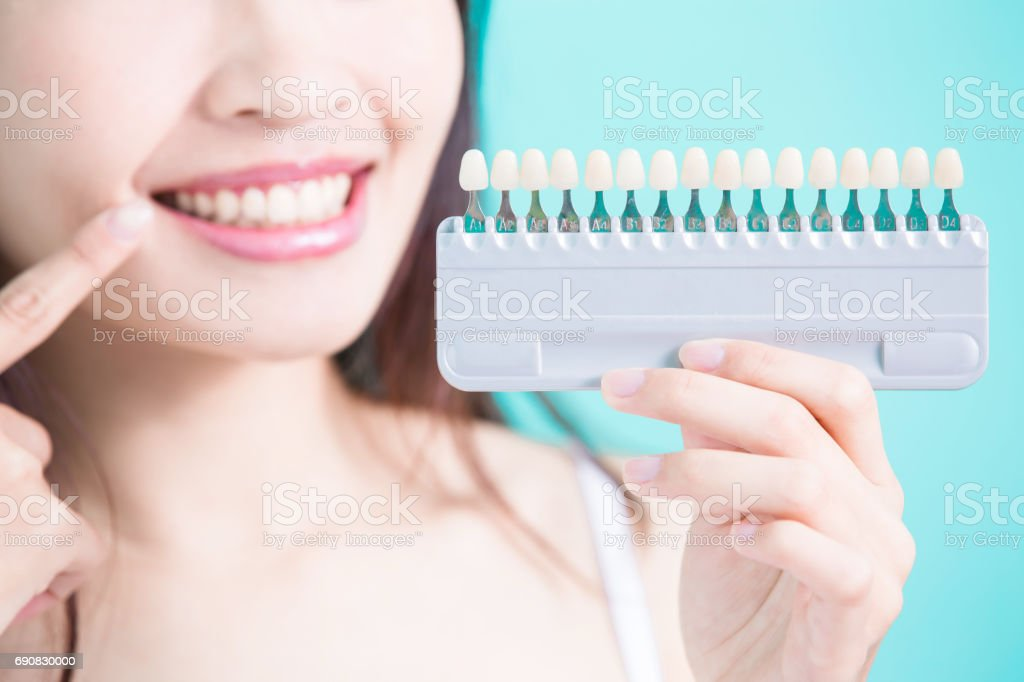 woman with tooth whiten stock photo
