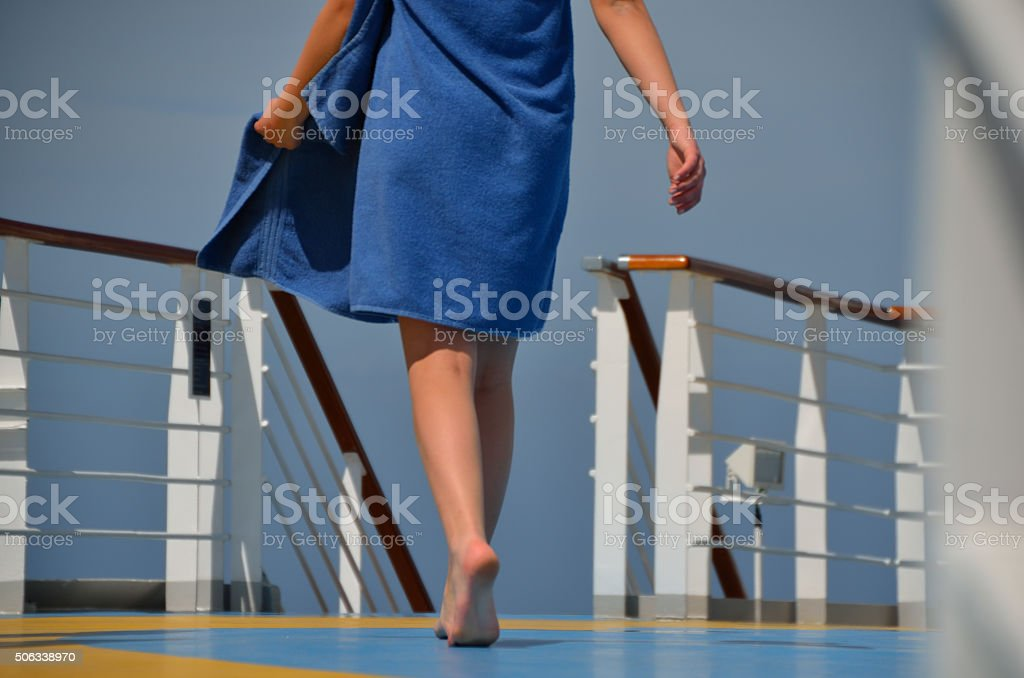 woman with towel on cruise ship stock photo