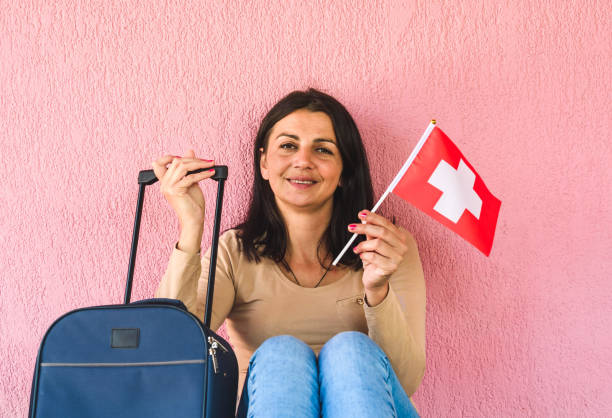 Woman with travel bag and flag of switzerland picture id1226574726?b=1&k=6&m=1226574726&s=612x612&w=0&h=spuko9ux7ocp1a59izzockobc m0dxxhttf pxhbfd0=