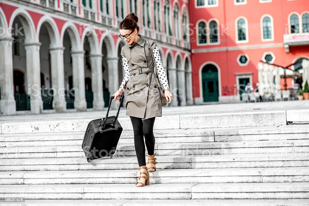 Woman with travel bag in the old city stock photo