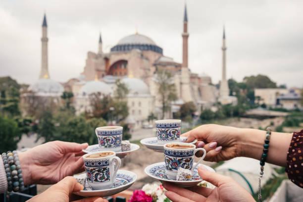 Woman with turkish coffee on Hagia Sophia bacground, Istanbul stock photo