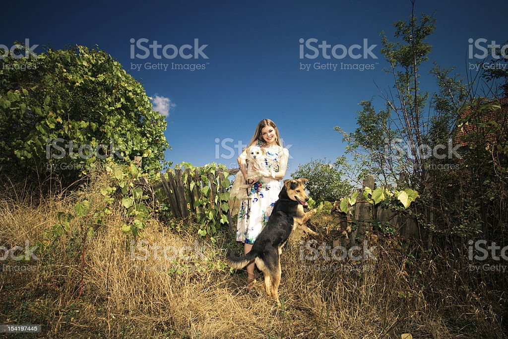 woman with two dogs royalty-free stock photo