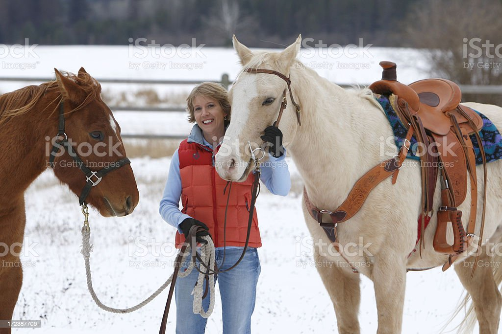 Woman with two horses royalty-free stock photo