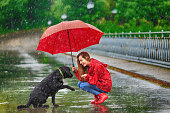 Woman with umbrella and dog