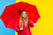 istock Woman with umbrella enjoying rainy day 802215792