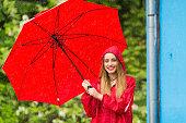 istock Woman with umbrella having fun in rainy day 1058231958