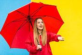 istock Woman with umbrella having fun in rainy day 832997332