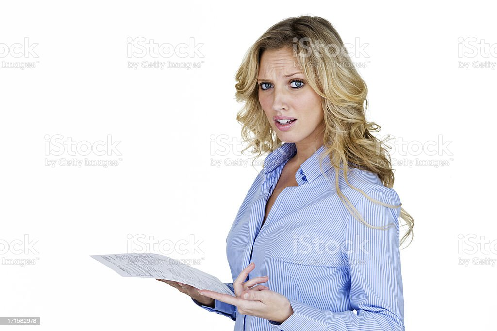 Woman with unhappy look pointing to a document royalty-free stock photo