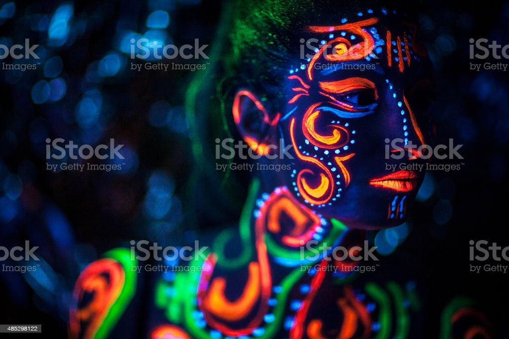 Woman With UV Bodypainting stock photo