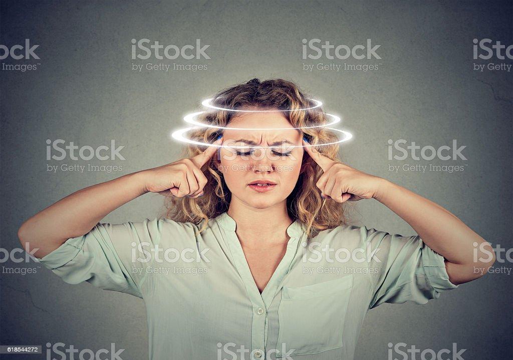 Woman with vertigo suffering from dizziness stock photo